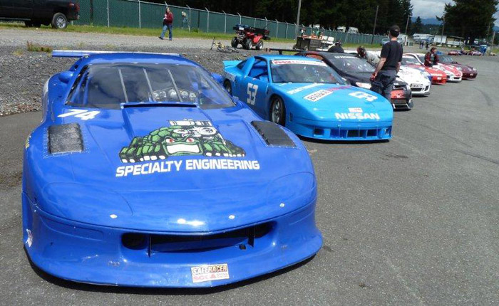 closeup of Specialty Engineering's #74 blue Chevy Camaro race car in the pre-grid lineup formation