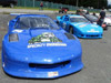 thumbnail image of Specialty Engineering's blue Camaro in the pre-grid